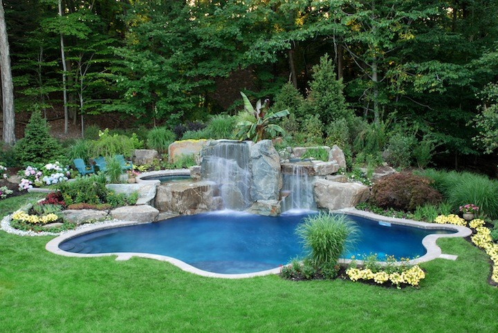 waterfalls for pools upper hot tub sheer waterfall cliffs natural waterfall decorative plants grass landscape blue wooden chairs