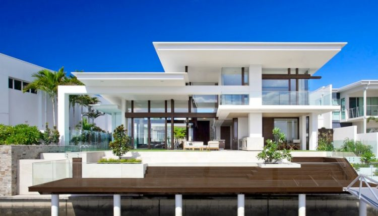 white house contemporary overhang glass walls glass balcony swimming pool mansion pendant lights