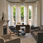 Window Treatment Ideas For Bay Windows Vintage Desk Custom Upholstery Couch White Rug Fireplace White Drapes