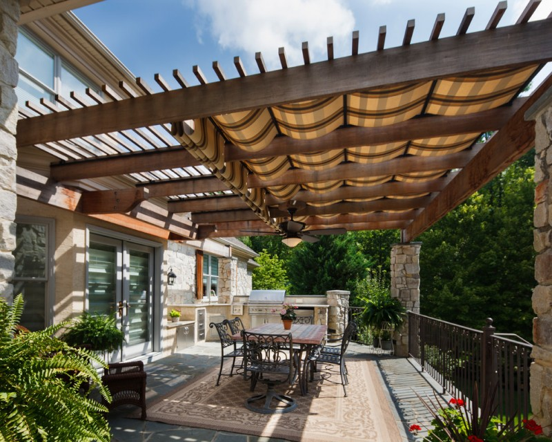 wooden pergola with shade curtain addition black wrought iron furniture for patio outdoor area rug concrete tiles floors