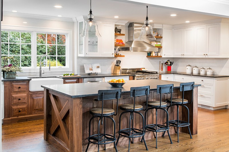 Large country l shaped eat in kitchen photo with a farmhouse sink, shaker cabinets, white cabinets, granite countertops, white backsplash, ceramic backsplash, stainless steel appliances, medium tone hard