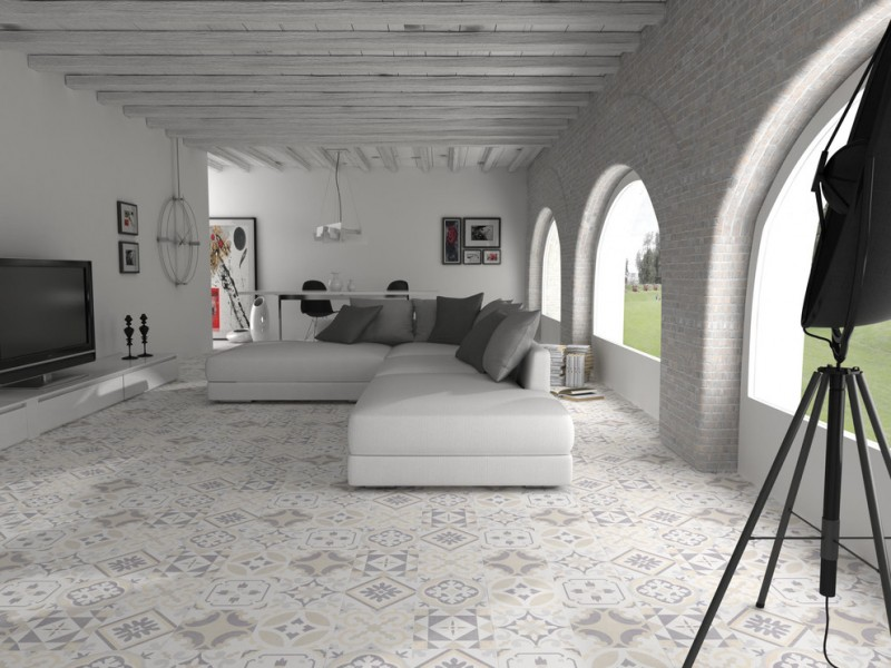 Moroccan style living room in white modern white sectional with grey accent pillows mosaic tiles floors curved & open windows built in media console freestanding TV set