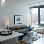 Apartment Living Room Ideas Industrial Style Ceiling Light Glass Window Blue And Grey Room Unique Table Grey Couch Dining Area Blue Bar Stools