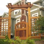 Arched Gate Cedar Fence Arbor Red Brick Green Wall
