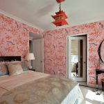 asian themed bedroom mandarin lantern pink painted wall with pink bamboo and birds pattern oval mirror mirrored door black table and chair