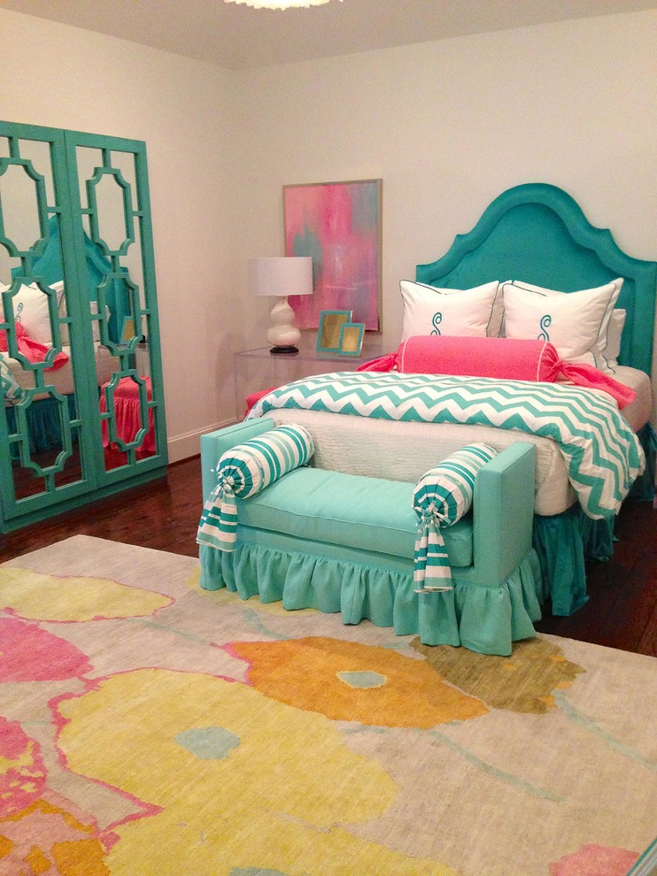 bed frame with blue headboard and slipcover blue settee with slipcover & accent pillows multicolored bedroom rug closet with mirror glass door beautified with decorative blue painted wood patterns