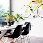 Bike Storage Apartment Creative Bike Rack Yellow Bicycle Wood Flooring Art Wall Decoration Black Chairs Beautiful Base Large Sliding Glass Door