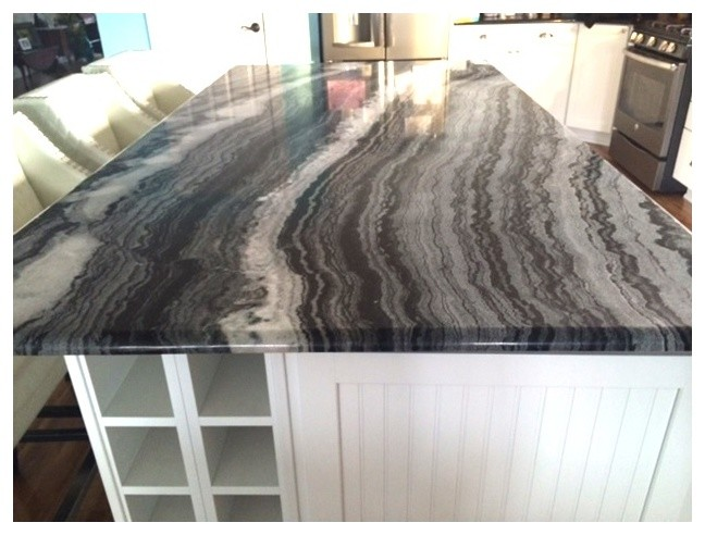 black and white granite countertop white cabinet white wine storage stainless steel appliances