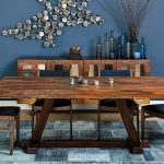 Bold Blue Walls Accented By Glass Wall Ornaments Well Ordered Glass Accent Bottles And Planter Hardwood Dining Cabinets Hardwood Dining Table Hardwood Dining Chairs With Dark Blue Seater
