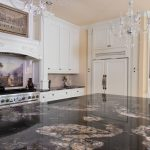 chandelier black and white granite countertop black appliances picture tiled backsplash flat panel cabinet decorated wall