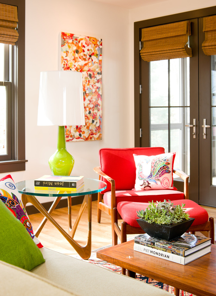 Colorful family room idea colorful vintage style furniture set red reading chair roun glass top side rivoli interior design