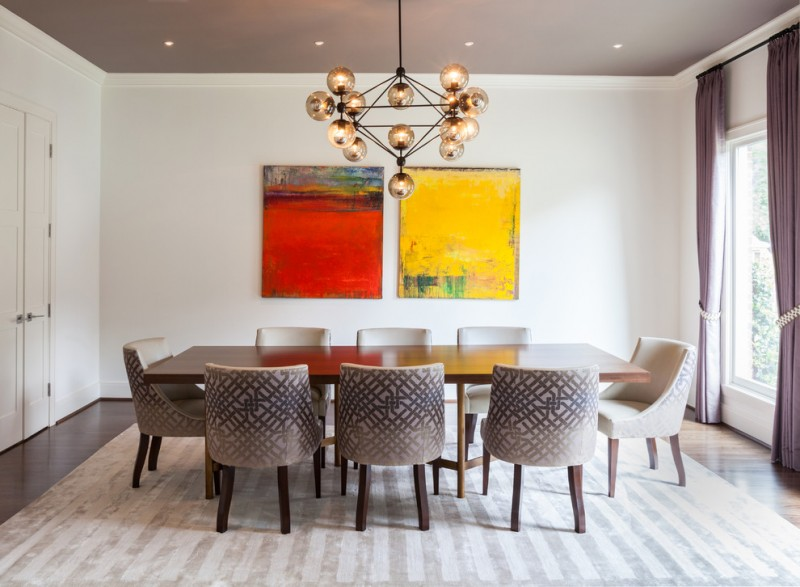 contemporary dining room with yellow and red abstract paintings white walls bright area rug with stripes decoration a set of dining furniture pendant lamp with glowing balls