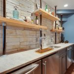 Contemporary Industrial Kitchen And Bar Idea With Industrial Open Shelves Made Of Wooden White Countertop Stainless Steel Appliances Grey Cabinets Pale Toned Industrial Bricks Backsplash Blue Walls