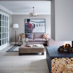 Contemporary Living Room Light Purple Sofa With Multicolored Accent Pillows Light Purple Center Table Light Toned Wood Floors Light Grey Walls Blue Fireplace With Under Logs Storage