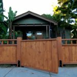 Craftsman Fence Front Yard Fence Wooden Fence Banana Trees Green Wooden House Wooden Door