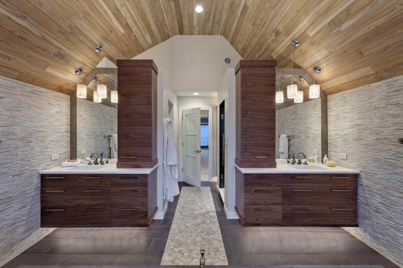 double vanity stone wall wooden ceiling pebble floor tiled floor ceiling lights arched ceiling undermount sink recessed lights