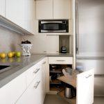 Flat Panel Corner Cabinet In White White Countertop White Ceramic Tiles Backsplash Stainless Steel Appliances White Ceramic Floors
