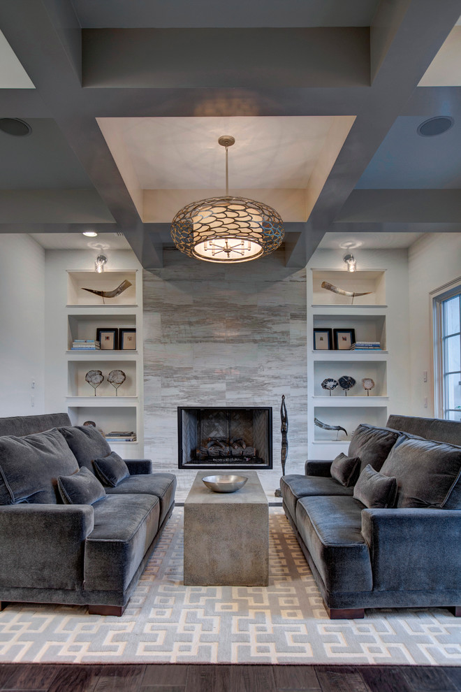 grey velvet couches with pillows built in concrete center table recessed shelving unit a standard fireplace with stones surround large pendant lamp