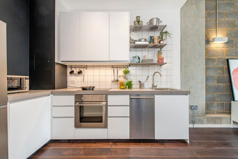 industrial kitchen concept with flat paneled cabinets in white lightweight metal shelving unit white ceramic tiles backsplash dark concrete walls dark toned floors stainless steel appliances