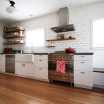 Industrial Kitchen Design Industrial Corner Kitchen Shelves White Subway Tiles Stainless Steel Appliances White Flat Panel Cabinets Medium Toned Wood Floors