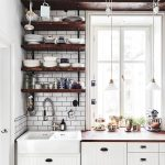 Industrial Open Shelves Made Of Dark Toned Hardwood White Subway Tiles Backsplash Flat Panel Cabinets In White Glass Windows Lower Pendant Lamps