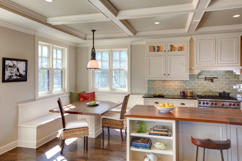 kitchen corner bench seating beautiful floor stove chairs shelves books windows backsplash wall cabinets dark countertop traditional room pillows