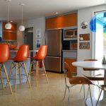 kitchen with sleek orange bar stool with back, wooden four lgs with support and leg rest