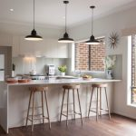 kitchen with white furniture, wooden floor, woden round sleek bar stool
