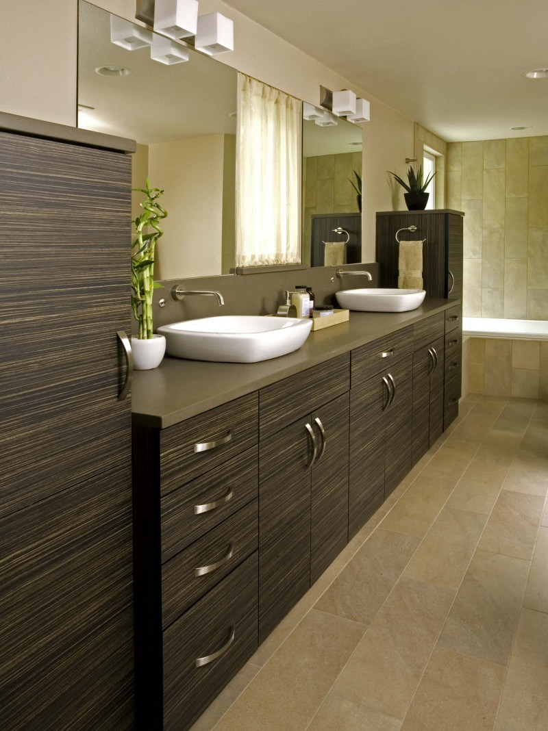 laminate vanity brown cabinet double vanity sink beige tiled wall porcelain floor built in tub bathroom lamps towel holder