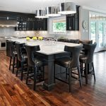 Large Kitchen Island With Black Body, White Marble Top, Black Wooden With Black Leather Seating Chairs