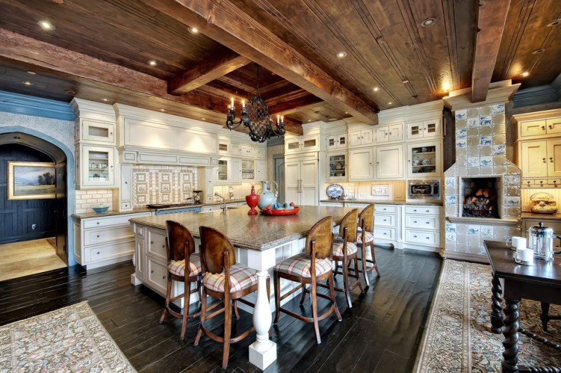 large kitchen island with white storage under and brown marble countertop, wooden stools with backs and plaid cushion seating