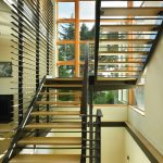 metal stair stringers bamboo treads hardwood floors window wall artwork railing contemporary design
