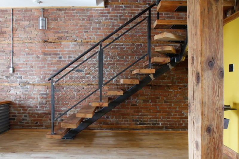 metal stair stringers bricks brick wall pillar stairs wood floor railing industrial staircase