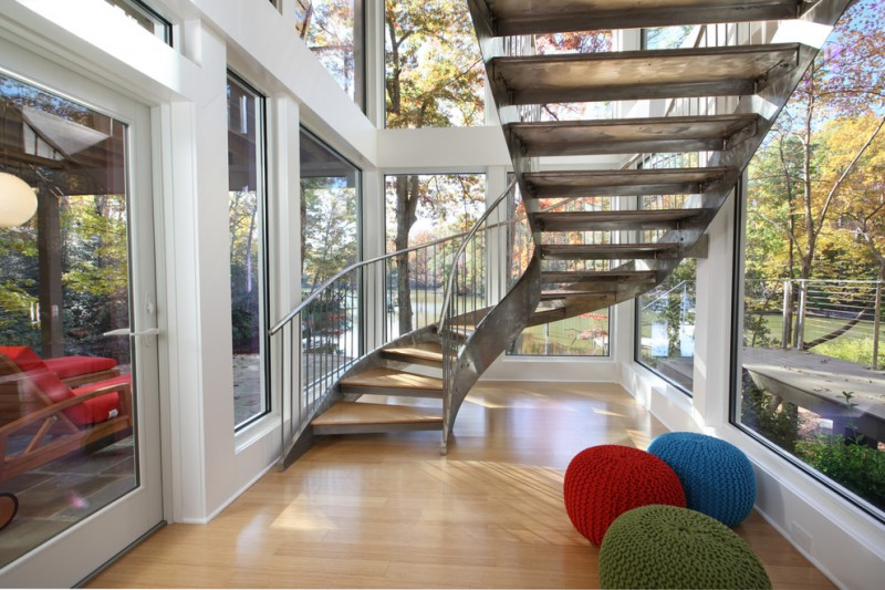 metal stair stringers hardwood floors pouffes loungers window walls deck railing staircase hardwood floors contemporary design