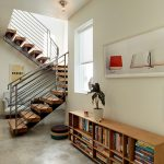 Metal Stair Stringers Marble Floors Armchair Bookshelves Window Artwork Pendants Staircase Contemporary Design