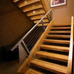 metal stair stringers staircase railings artwork hardwood floors lights industrial design