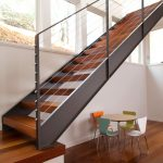 metal stairs stringers hardwood floors chairs round table large windows contemporary design