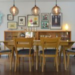 midcentury dining set with long rectangle wooden table, wooden chairs with black cushion