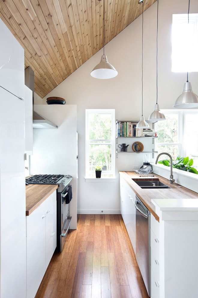 modern industrial kitchen idea with small corner industrial shelving small sized worktop made of wooden stainless steel appliances wood top island stainless steel farmhouse sink
