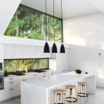 Modern Kitchen Idea Marble Countertop Marble Kitchen Bar With Light Toned Wood Bar Stools Flat Paneled Kitchen Cabinets Stainless Steel Appliances Modern Black Pendant Lamps