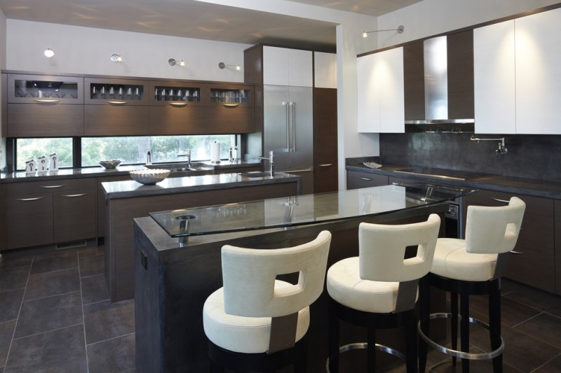 modern kitchen in brown palette with brown kitchen island with glass top, white round leather seating bar stools with back