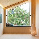 Modern Minimalist Bench With Black Fabric Foam Seater Asymmetrical Bay Window Light Wood Interior Scheme Simple Sconces