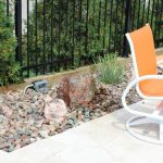 Modern Patio Idea With Modern Orange Chairs With White Frame Hardscape Area Concrete Patio Floors