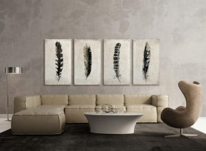 modern sectional in pale tone modern white center table dark grey velvet rug framed feather prints ornaments modern standing lamp made of stainless steel concrete walls