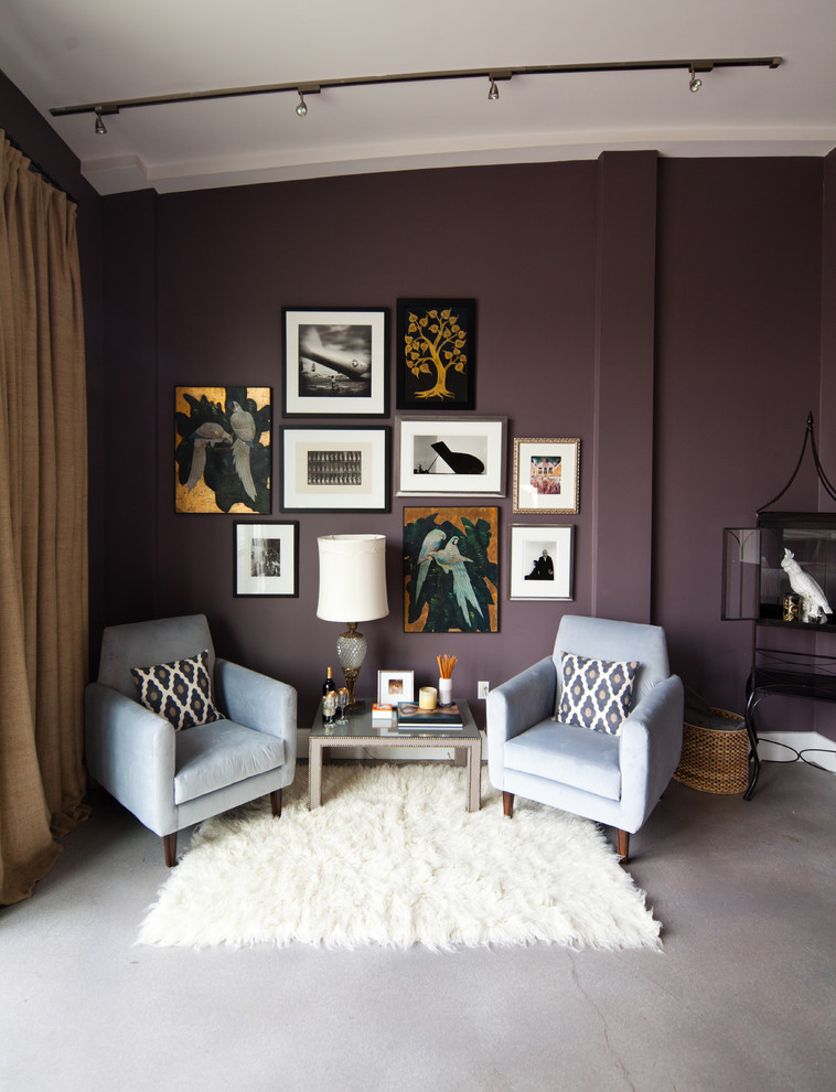 modern small living room a couple of light blue chairs small sized fluffy white area rug small center table bold purple walls some wall arts grey concrete floors