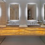 onyx vanity with LED lighted mirrors with aluminium sink