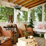 porch roof designs exposed beams potted plants screened porch suitcases throw pillows wicker furniture wood flooring wood trim