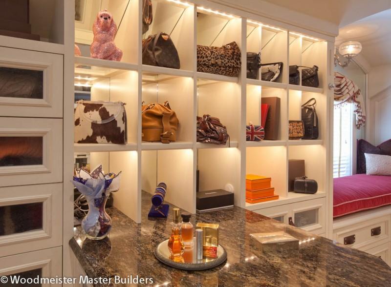 purse storage ideas display shelves glazed cabinetry handbag storage marble counter top antique pendant window seat pink cushion nice lighting