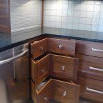 Reclaimed Wood Corner Cabinets With Raised Handles White Ceramic Tiles Backsplash Black Granite Countertop Stainless Steel Appliances White Ceramic Tiles Floors