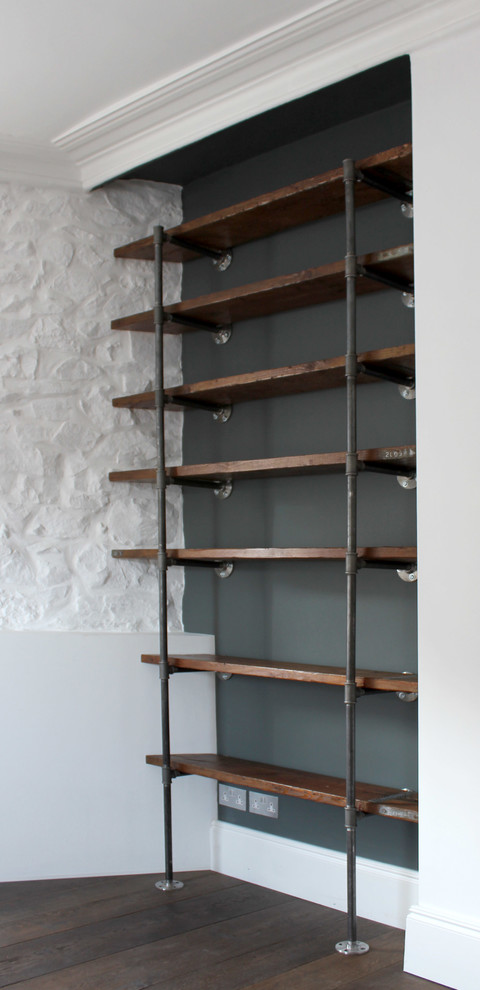 reclaimed wood industrial shelves idea supported by black wrought iron pipes and made of hardwood